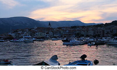 Time lapse sunset in city Baska with boats