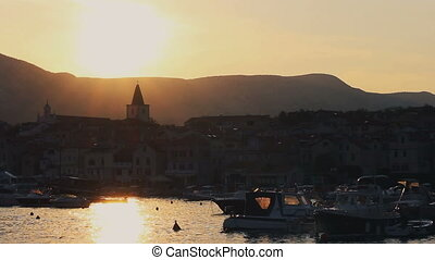 Time lapse sunset in city Baska with ships