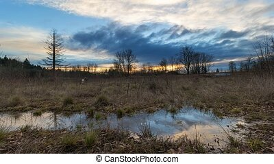 Time lapse sunset in floodplain - Ultra High Definition 4k...
