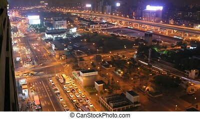 Time lapse traffic at night in bustling Taipei City