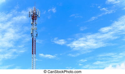 Time Lapse : Telecommunications antenna for radio, television and telephone white cloud and Blue sky