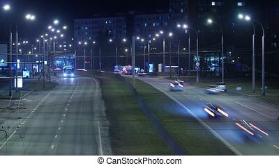 Time lapse, the light trails of city traffic on the building...