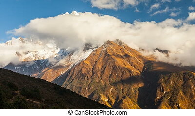 Time lapse. The movement of clouds near the majestic Mount Kangtega. Himalayas. Sagarmatha National Park, Nepal