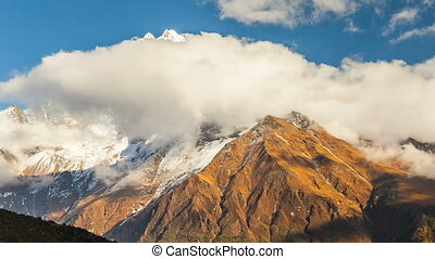 Time lapse. The movement of clouds near the majestic Mount...