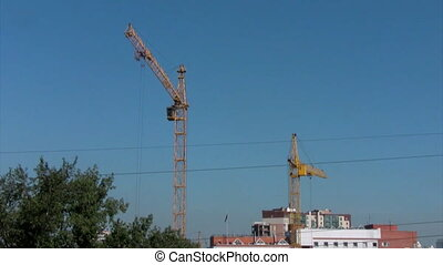 Time lapse the work of two cranes