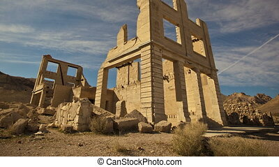Time lapse tilt shot of an old abandoned bank building ruin, Rhyolite Ghost Town near Death Valley, Nevada
