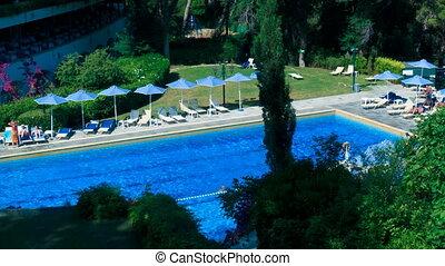 Time lapse: tourists near pool