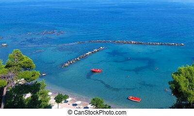 Time lapse: tourists on Corfu beach