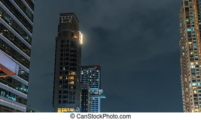 Time-lapse Tower building at night with fast moving clouds in the sky, close up