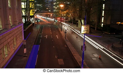 time-lapse traffic and street scene shot at night in london, with overlayed graphics