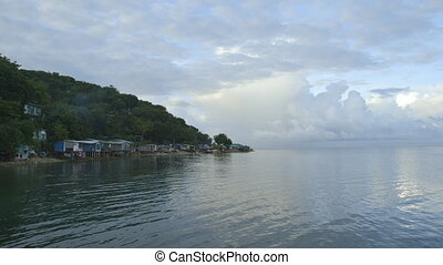 Time lapse view of a fishing village in Papua new guinea -...