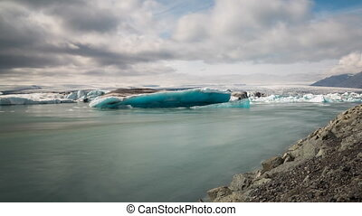 blue icebergs floating - Time lapse view of blue icebergs...