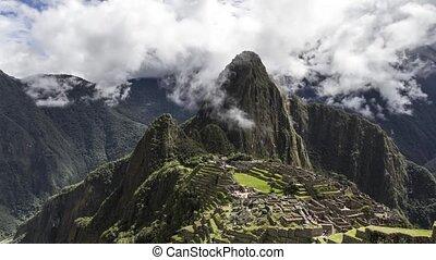 Machu Picchu in the clouds - Time lapse view of Machu Picchu...