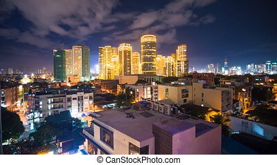 Time lapse view of Makati skyscrapers in Manila city. Skyline at night, Philippines.