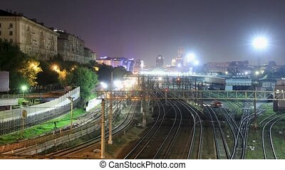 Time lapse view of railway station and metro line, train...