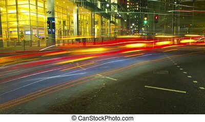 Time lapse view on busy traffic road highway full of bright light illumination flash in evening night London cityscape