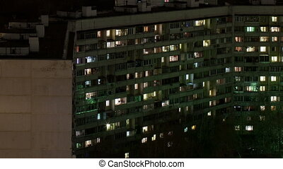 Time lapse windows of building at night.