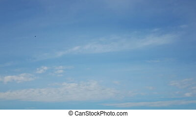 time lapse with clouds moving against the background of the blue sky in sunny day
