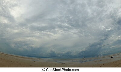 Time-lapse with dark rainy sky over the sea