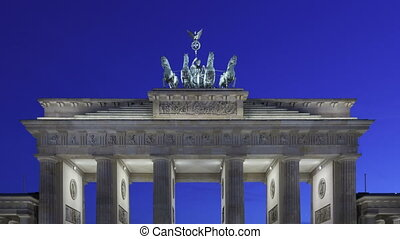 Time lapse zoom out of Brandenburg Gate at sunset with twilight and the Quadriga on top of the gate in Berlin