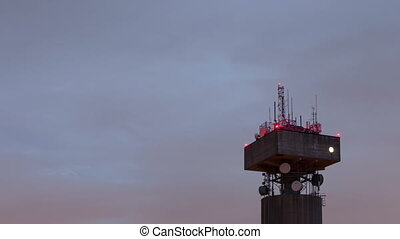 time lapse zoom in of a telecommunications tower with...