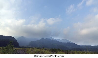 Time lapse,clouds over Merapi the most active in Indonesia the active volcano located on Java Island near the city of Yogyakarta