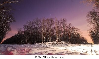Time lapses. Night in the winter forest. A lot of snow.