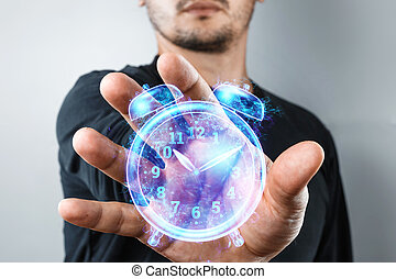 Time management concept, A man shows a hologram of a clock close-up. Hourly poes, passage of time, dead line. Copy space.