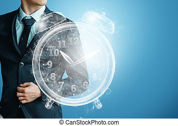 Time management concept, businessman next to the clock hologram. Hourly poes, passage of time, dead line. Copy space.