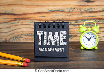 Time management concept. Notebook on wooden table