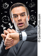 Time management concept - Businessman with wrist watch, time...