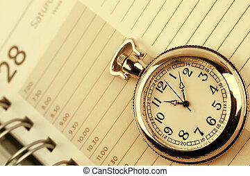 Time management - Pocket watch on diary page