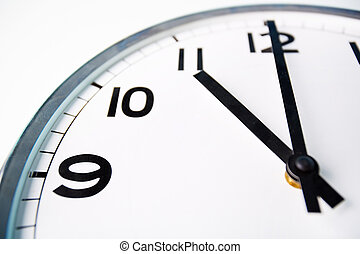 Time o?clock - Macro shot of a clock face showing eleven...