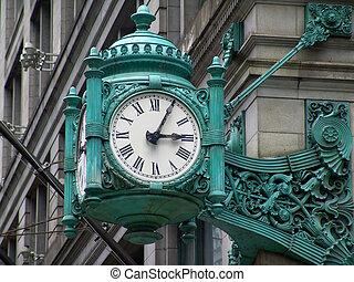 Time - Old stylish clock on a street corner