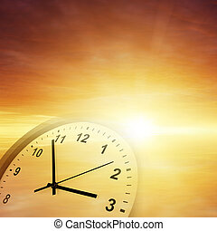 Time passing - Clock face in orange sky