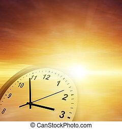Time passing - Clock face in orange sky