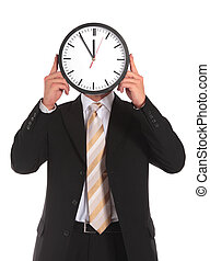 Time pressure - A businessman holding a clock that shows the...