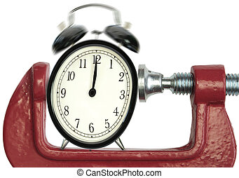 Time pressure deadline - Ringing alarm clock being squeezed ...