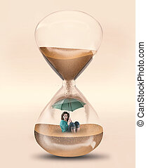 Time pressure hourglass - Girl with an umbrella inside a ...