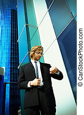 time pressure - Young business man standing in the big city ...