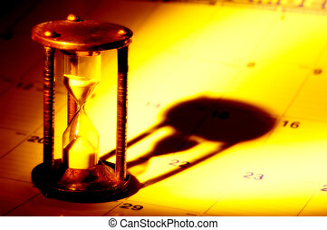 Time - Hourglass on a Calendar With Creative Lighting. See...