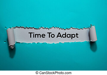 Time To Adapt Text written in torn paper