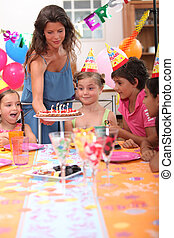 Time to blow out the candles at a child's birthday party
