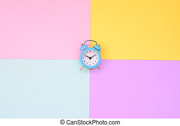 Time to choose metaphor concept. Alarm clock at the crossroads of different colors
