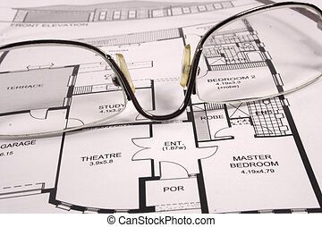 time to consider - set of glasses on a new home plan as the ...