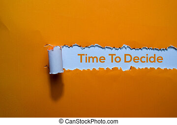 Time To Decide Text written in torn paper