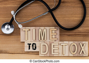 Time to Detox - text in vintage letters on wooden blocks with stethoscope