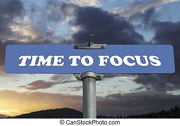 Time to focus road sign
