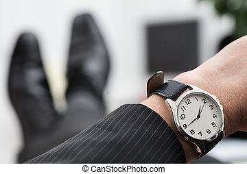 Time to go home - Relaxed businessman waiting to the end of...