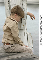 Time to grieve - Sad or grieving boy